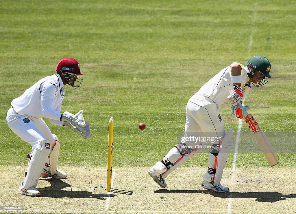 David Warner of Australia is caught behind by Denesh Ramdin of the West Indies during day one of the First Test match between Australia and the West Indies at Blundstone Arena on December 10, 2015 in Hobart, Australia.