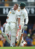 David Warner of Australia is congratulated by Usman Khawaja of Australia after reaching his century during day one of the First Test match between...