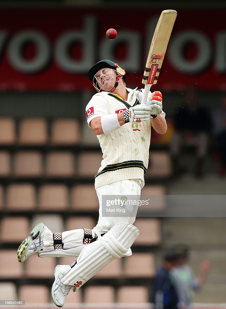 David Warner of Australia is hit by a bouncer during day one of the First Test match between Australia and Sri Lanka at Blundstone Arena on December 14, 2012 in Hobart, Australia.