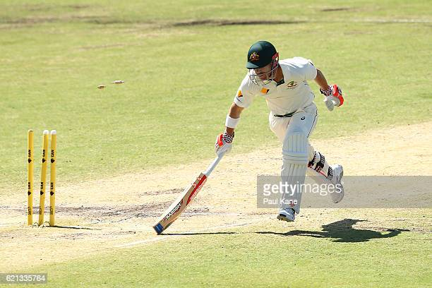 David Warner of Australia is run out by a direct hit by Temba Bavuma of South Africa during day four of the First Test match between Australia and...