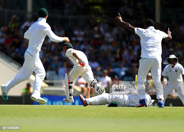 David Warner of Australia is run out by Temba Bavuma of South Africa during day four of the First Test match between Australia and South Africa at...