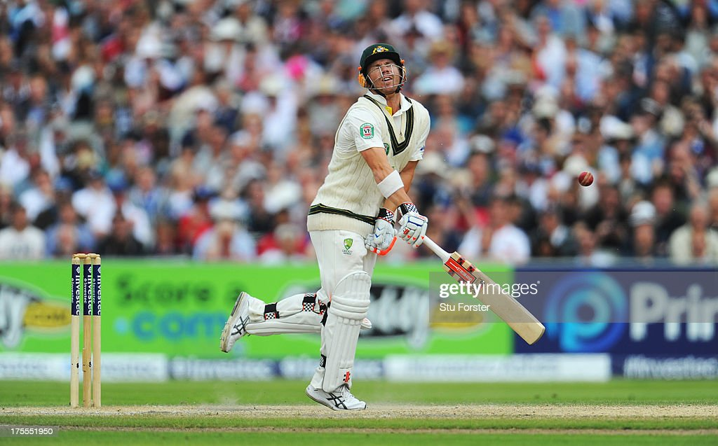 David Warner of Australia is struck by a delivery from Tim Bresnan of England during day four of the 3rd Investec Ashes Test match between England and Australia at Emirates Old Trafford Cricket Ground on August 4, 2013 in Manchester, England.
