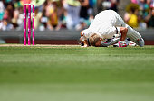 David Warner of Australia kisses the ground at the spot where the late Phillip Hughes fell after reaching 63 during day one of the Fourth Test match...