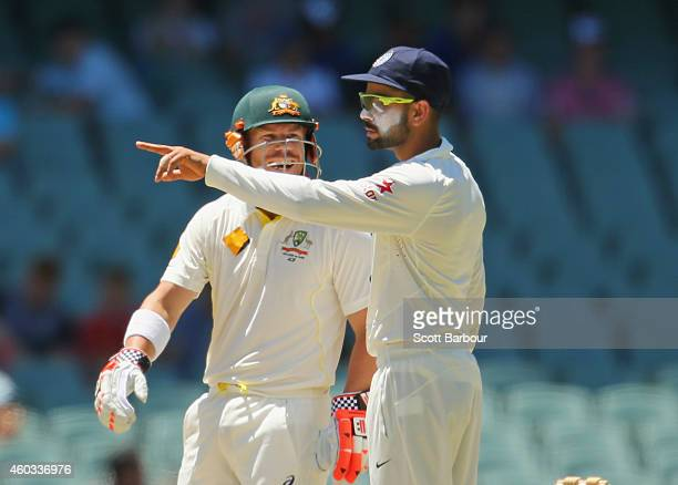 David Warner of Australia laughs as Virat Kohli captain of India sets his field during day four of the First Test match between Australia and India...