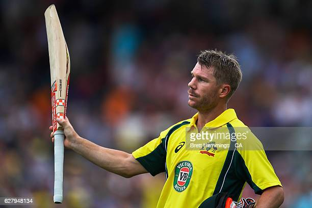 David Warner of Australia leaves the field after being dismissed by Colin de Grandhomme of New Zealand during game two of the One Day International...
