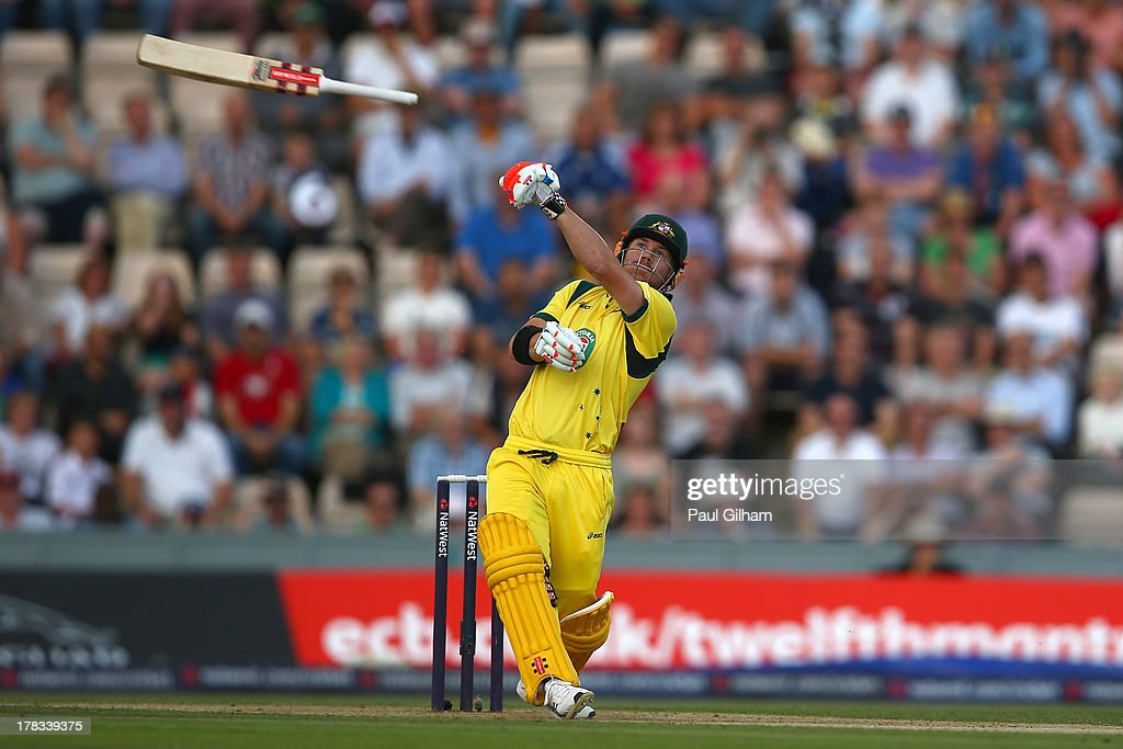 <a gi-track='captionPersonalityLinkClicked' href=/galleries/search?phrase=David+Warner+-+Cricketer&family=editorial&specificpeople=4262255 ng-click='$event.stopPropagation()'>David Warner</a> of Australia lets go of his bat as he hits out only to be caught out by Jos Buttler of England for 1 run off the bowling of Stuart Broad during the 1st NatWest Series T20 match between England and Australia at Ageas Bowl on August 29, 2013 in Southampton, England.
