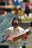 David Warner of Australia looks up to the sky in tribute to the late Phillip Hughes after reaching 63 during day one of the First Test match between...