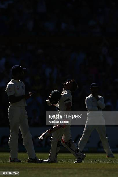 David Warner of Australia looks up to the sky in tribute to the late Phillip Hughes after making his century during day four of the First Test match...