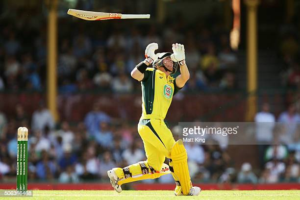 David Warner of Australia loses his bat after a full toss from Jasprit Bumrah of India during game five of the Commonwealth Bank One Day Series match...