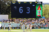 David Warner of Australia pays tribute to the late Phillip Hughes after reaching 63 during day one of the First Test match between Australia and...