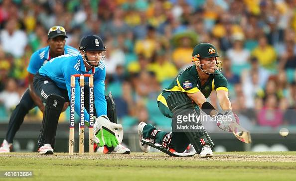 David Warner of Australia plays a reverse sweep shot during the One Day International series match between Australia and England at Sydney Cricket...