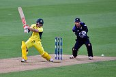 David Warner of Australia plays a shot as New Zealand's wicketkeeper Luke Ronchi reacts during the second oneday international cricket match between...