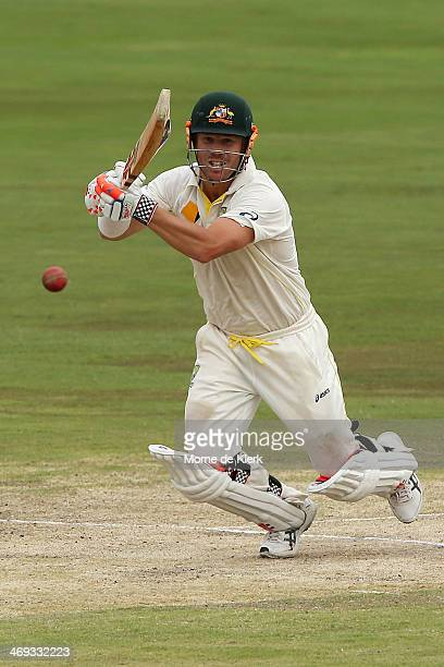 David Warner of Australia plays a shot to bring his score to 100 runs during day three of the First Test match between South Africa and Australia on...