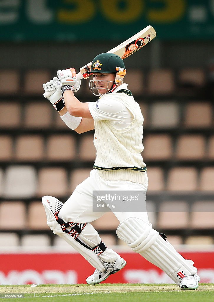 David Warner of Australia plays an off side shot during day one of the First Test match between Australia and Sri Lanka at Blundstone Arena on December 14, 2012 in Hobart, Australia.