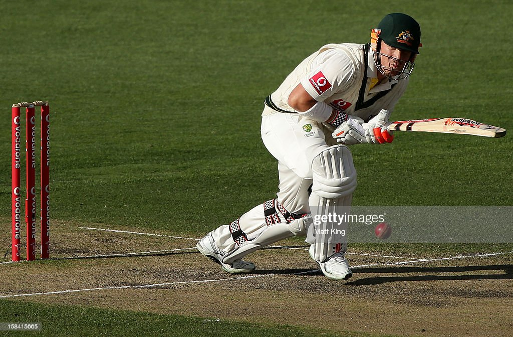 David Warner of Australia plays an on side shot during day three of the First Test match between Australia and Sri Lanka at Blundstone Arena on December 16, 2012 in Hobart, Australia.