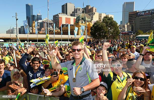 David Warner of Australia poses infront of the crowd during celebrations after winning the 2015 ICC Cricket World Cup Final at Federation Square on...