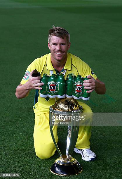 David Warner of Australia poses with the trophy on the ground at 215am after the 2015 ICC Cricket World Cup final match between Australia and New...