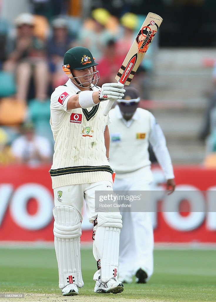 David Warner of Australia raises his bat after scoring his half century during day one of the First Test match between Australia and Sri Lanka at Blundstone Arena on December 14, 2012 in Hobart, Australia.