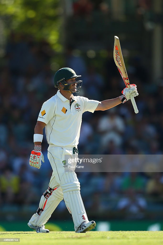 David Warner of Australia raises his bat to celebrate his 150 during day one of the second Test match between Australia and New Zealand at WACA on November 13, 2015 in Perth, Australia.