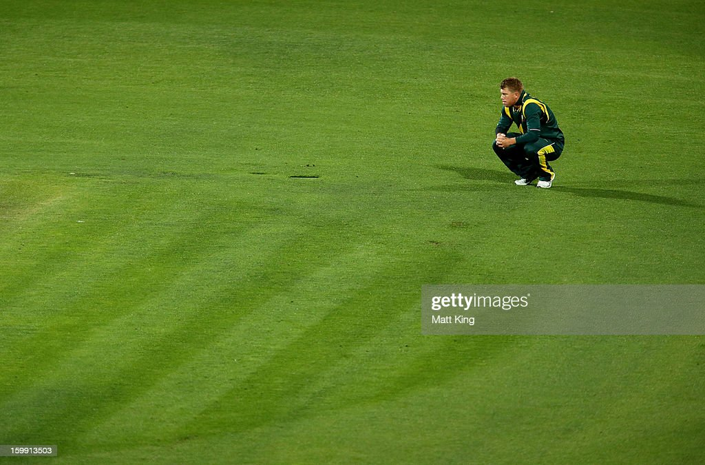 David Warner of Australia reacts after a missed runout opportunity during game five of the Commonwealth Bank One Day International series between Australia and Sri Lanka at Blundstone Arena on January 23, 2013 in Hobart, Australia.