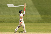 David Warner of Australia reacts after scoring his half century during day one of the First Test match between Australia and India at Adelaide Oval...