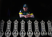 David Warner of Australia rests during a rain delay during game five of the One Day International series between Australia and South Africa at Sydney...