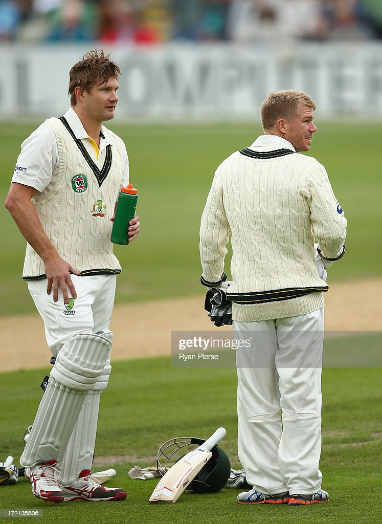 David Warner of Australia runs a drink out to Shane Watson of Australia during day one of the Tour Match between Worcestershire and Australia at New Road on July 2, 2013 in Worcester, England.