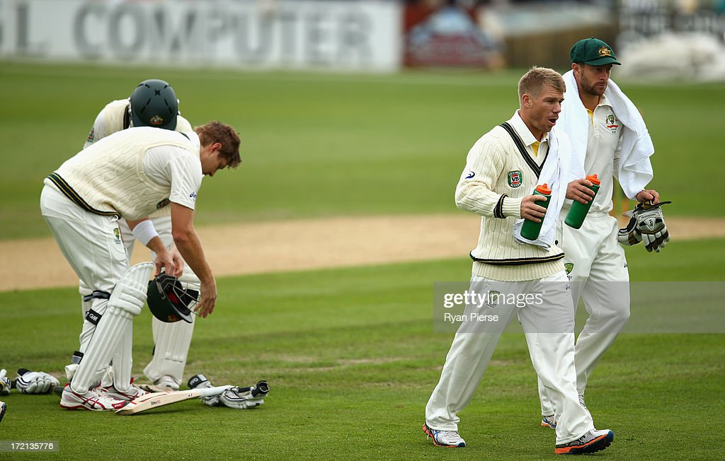 David Warner of Australia runs drinks to the batsmen during day one of the Tour Match between Worcestershire and Australia at New Road on July 2, 2013 in Worcester, England.
