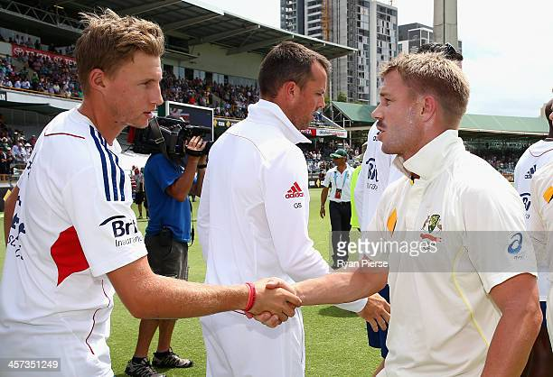 David Warner of Australia shakes hands with Joe Root of England during day five of the Third Ashes Test Match between Australia and England at WACA...