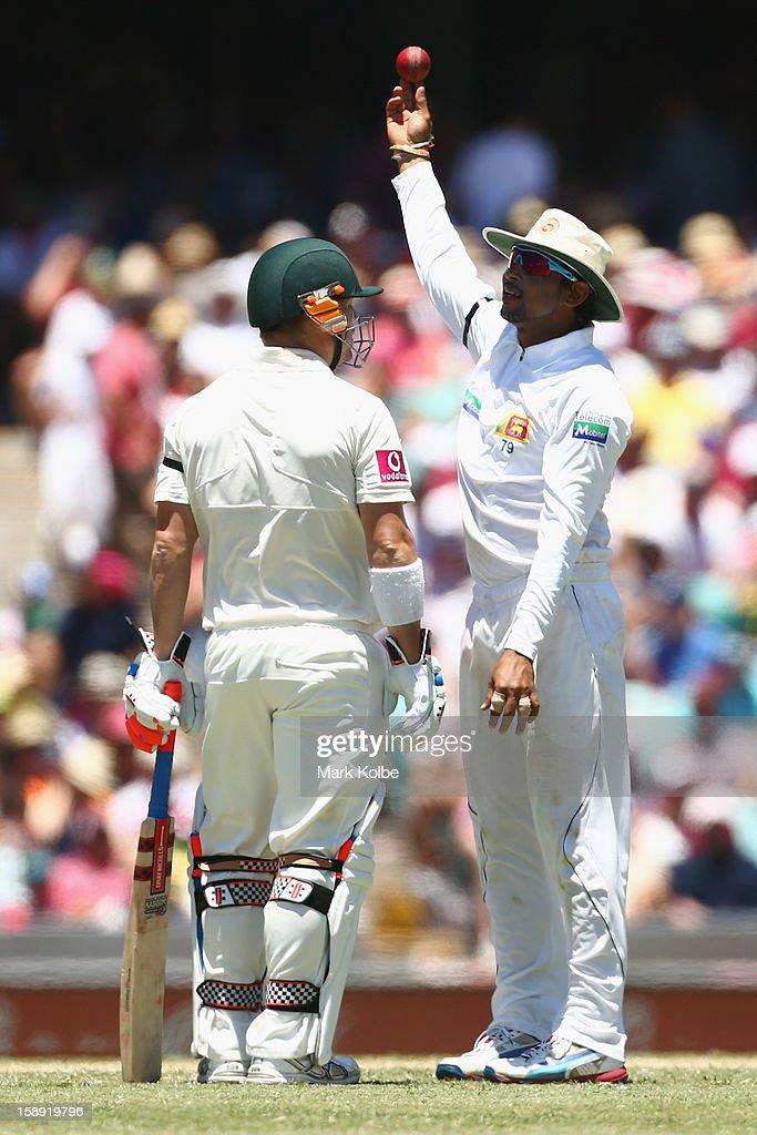 David Warner of Australia speaks to Angelo Mathews of Sri Lanka during day two of the Third Test match between Australia and Sri Lanka at Sydney Cricket Ground on January 4, 2013 in Sydney, Australia.