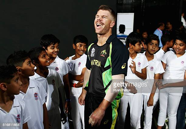 David Warner of Australia speaks with local children during the ICC World Twenty20 India 2016 Super 10s Group 2 match between Australia and...