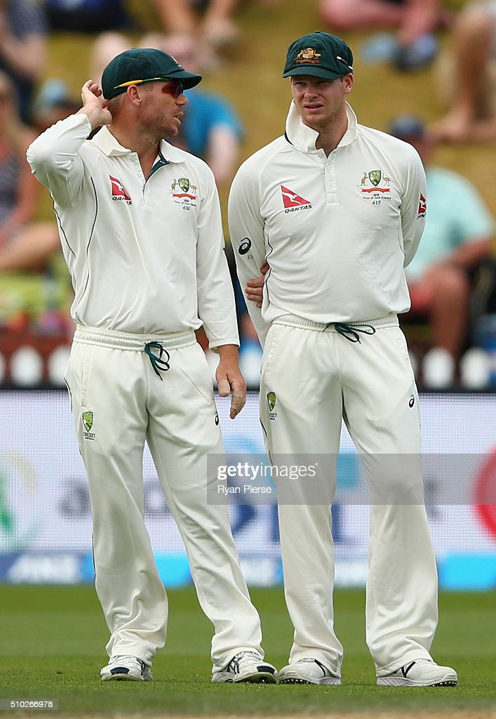 David Warner of Australia speaks with Steve Smith of Australia during day four of the Test match between New Zealand and Australia at Basin Reserve on February 15, 2016 in Wellington, New Zealand.