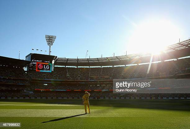David Warner of Australia stands in the outfield during the 2015 ICC Cricket World Cup final match between Australia and New Zealand at Melbourne...