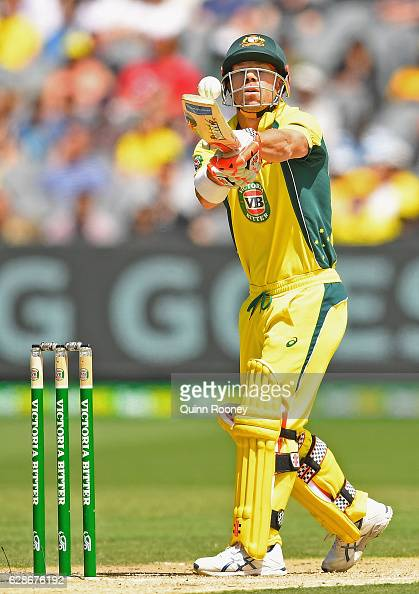 David Warner of Australia stops a ball from hitting his stumps during game three of the One Day International series between Australia and New...