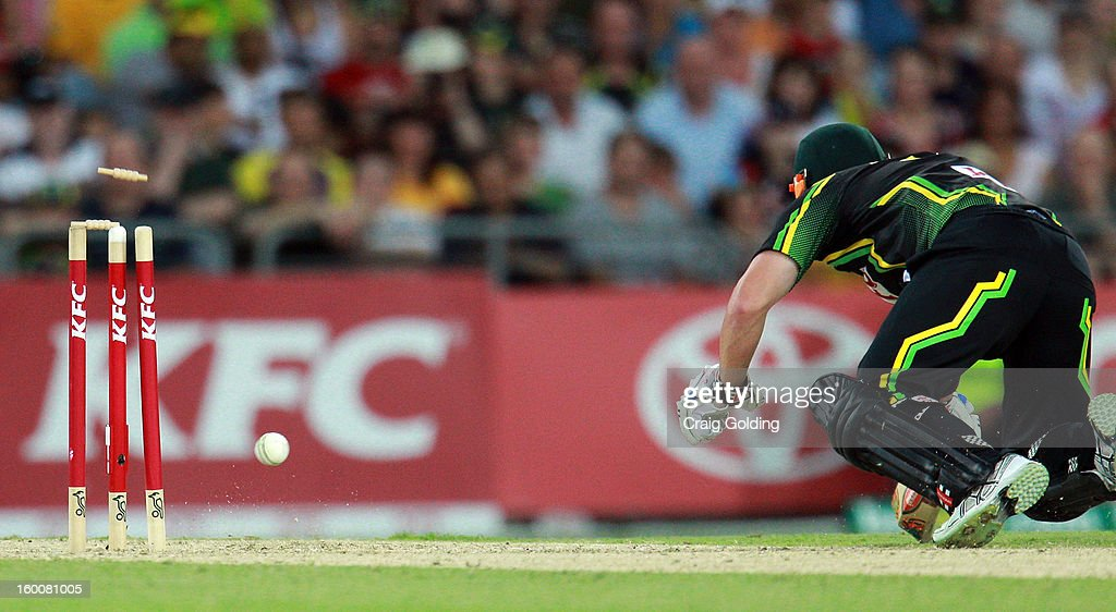 David Warner of Australia survives runout during game one of the Twenty20 international match between Australia and Sri Lanka at ANZ Stadium on January 26, 2013 in Sydney, Australia.