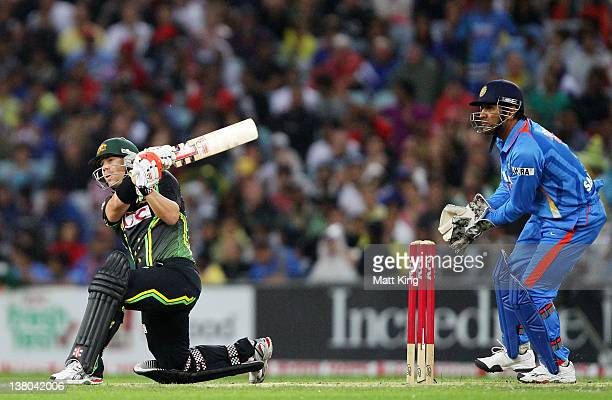 David Warner of Australia switch hits for six during the International Twenty20 match between Australia and India at ANZ Stadium on February 1 2012...