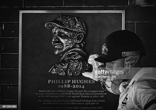 David Warner of Australia touches the tribute to the late Philip Hughes as he walks out to bat during day one of the Fourth Test match between...