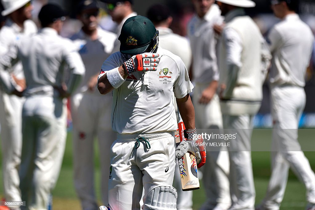 David Warner of Australia walks from the field after being caught during the first cricket Test match between New Zealand and Australia at the Basin Reserve in Wellington on February 12, 2016. AFP PHOTO / MARTY MELVILLE / AFP / Marty Melville