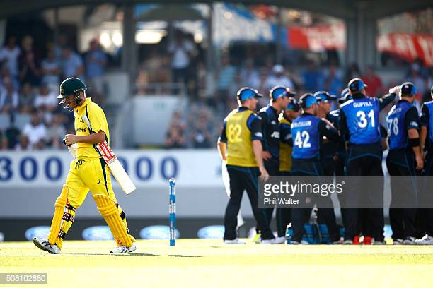 David Warner of Australia walks off the field out LBW off the bowling of Trent Boult of New Zealand during the One Day International match between...