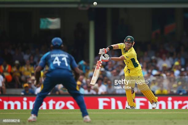 David Warner of Australia watches on as he is about to be caught by Seekuge Prasanna of Sri Lanka during the 2015 ICC Cricket World Cup match between...