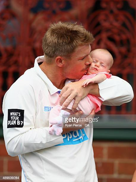David Warner of New South Wales kisses his daughter Ivy during the lunch break during day one of the Sheffield Shield match between New South Wales...