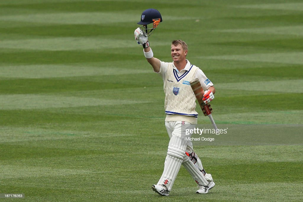David Warner of the Blues celebrates his century during day two of the Sheffield Shield match between the Victoria Bushrangers and the New South Wales Blues at Melbourne Cricket Ground on November 7, 2013 in Melbourne, Australia.