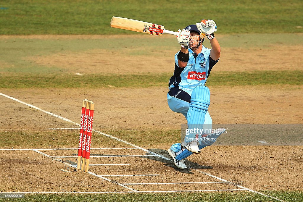David Warner of the Blues is hit by a bouncer during the Ryobi Cup match between the New South Wales Blues and the Victorian Bushrangers at North Sydney Oval on October 20, 2013 in Sydney, Australia.