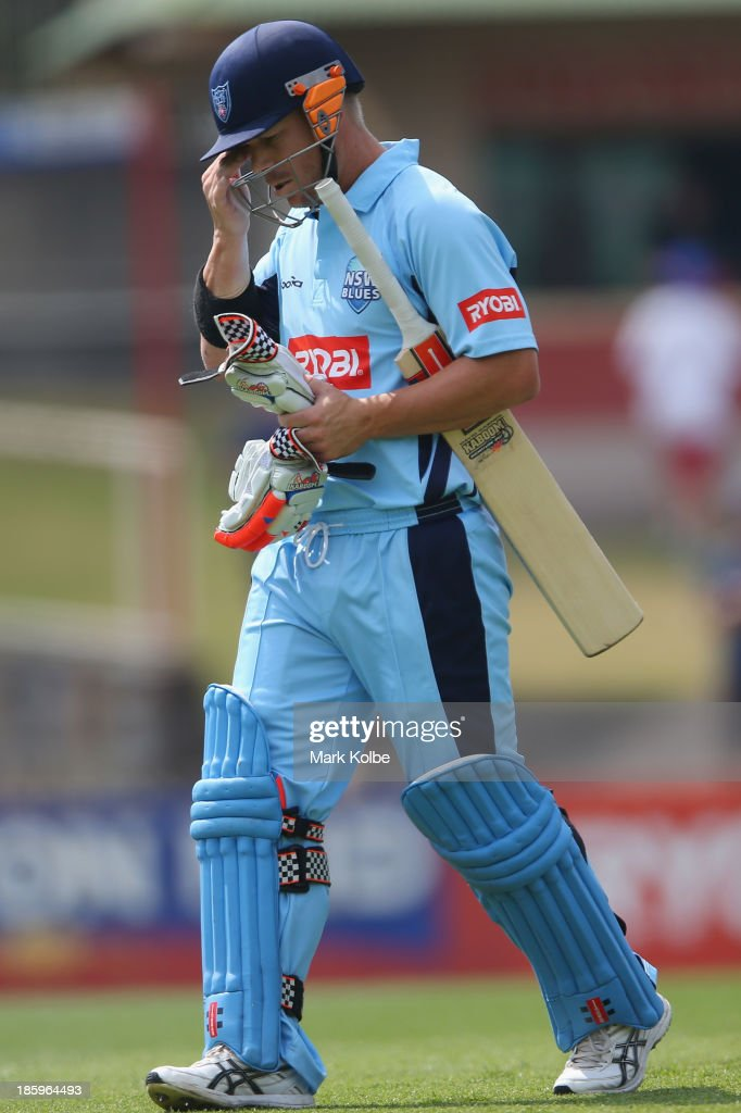 David Warner of the Blues looks dejected as he leaves the field after being dismissed during the Ryobi Cup Final match between the Queensland Bulls and the New South Wales Blues at North Sydney Oval on October 27, 2013 in Sydney, Australia.