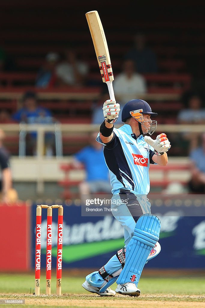 David Warner of the Blues plays a cover drive during the Ryobi Cup match between the New South Wales Blues and the Victorian Bushrangers at North Sydney Oval on October 20, 2013 in Sydney, Australia.