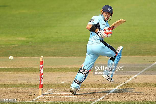 David Warner of the Blues plays a stoke on the leg side during the Ryobi Cup match between the New South Wales Blues and the Victorian Bushrangers at...