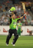 David Warner of the Thunder reaches his century during the T20 Big Bash League match between the Melbourne Stars and the Sydney Thunder at Melbourne...