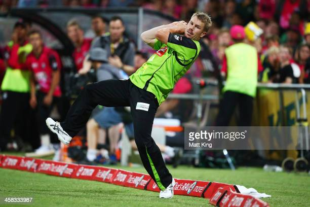 David Warner of the Thunder takes a catch on the boundary to dismiss Michael Lumb of the Sixers during the Big Bash League match between the Sydney...