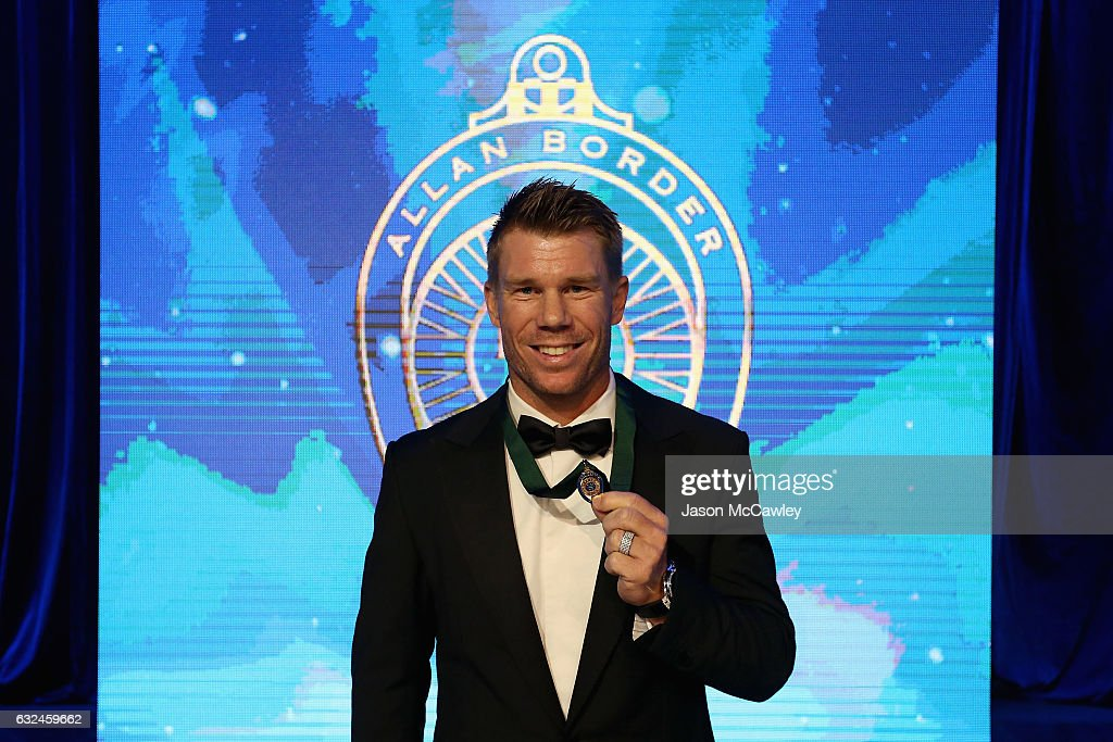 David Warner poses on stage after winning the 2017 Allan Border Medal at The Star on January 23, 2017 in Sydney, Australia.
