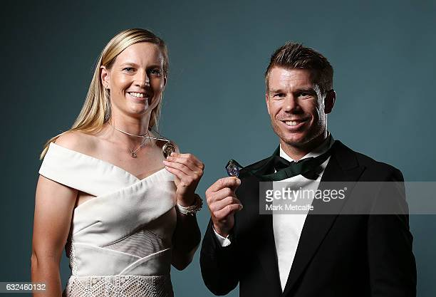 David Warner poses with the Allan Border Medal and Meg Lanning poses with the Belinda Clark Award during the 2017 Allan Border Medal at The Star on...